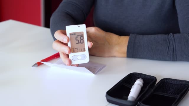 senior  woman checking glucose level at home - glucose stock videos & royalty-free footage