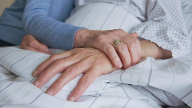 senior woman comforting hospitalized husband - visit stock videos & royalty-free footage