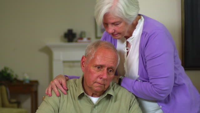 ms senior woman comforting husband, austin, texas, usa - illness stock videos & royalty-free footage