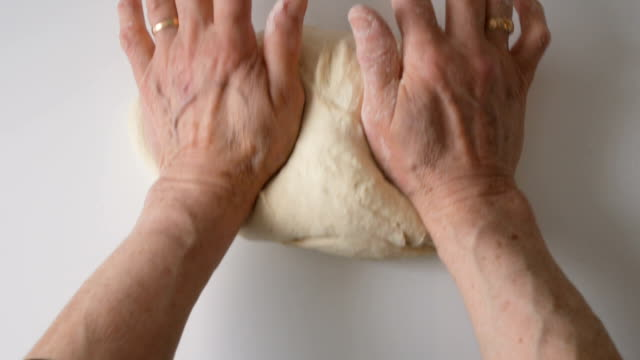 senior woman cooking. kneading dough - cucina mediterranea video stock e b–roll