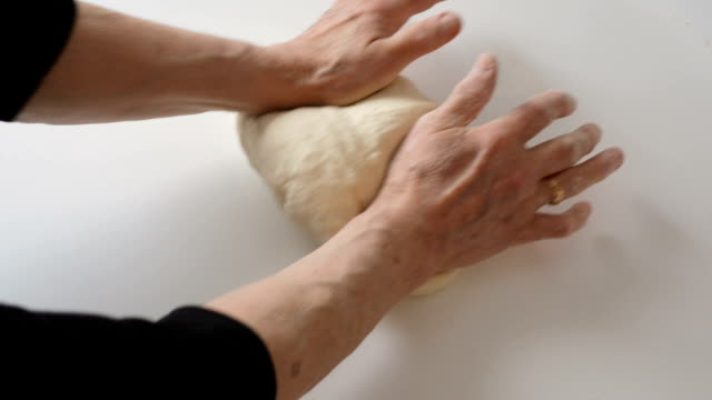 senior woman cooking. kneading dough - kneading stock videos and b-roll footage
