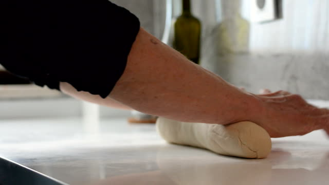 dolly: senior woman cooking. kneading dough - cucina mediterranea video stock e b–roll