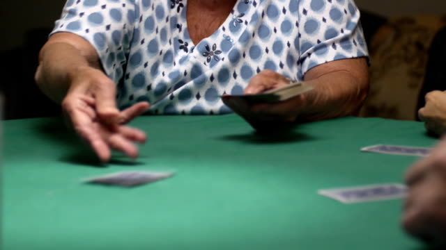 senior woman deals cards - dealing cards stock videos and b-roll footage