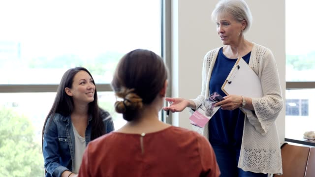 senior woman discusses breast cancer remission with support group - charity benefit stock videos & royalty-free footage