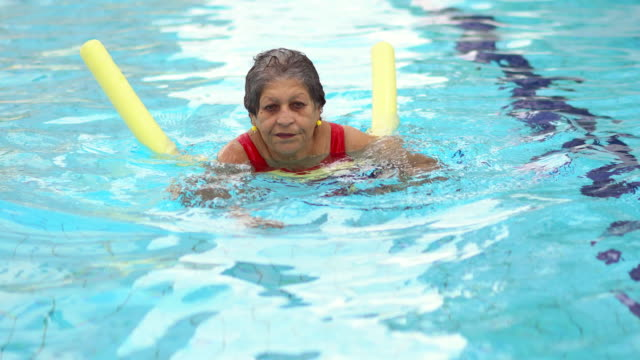 senior woman doing aqua aerobic - 70 79 years stock videos and b-roll footage