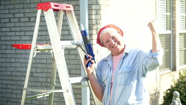 senior woman doing home maintenance - flexing muscles stock videos & royalty-free footage