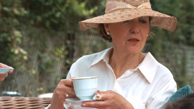 senior woman drinking afternoon tea - tea party stock videos and b-roll footage