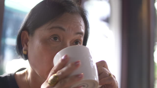 senior woman drinking coffee - solitude stock videos & royalty-free footage