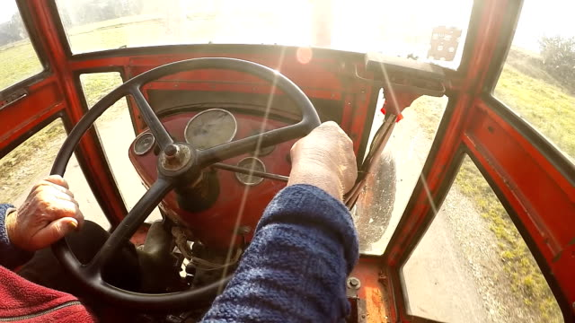 SLO MO Senior Woman Driving A Tractor