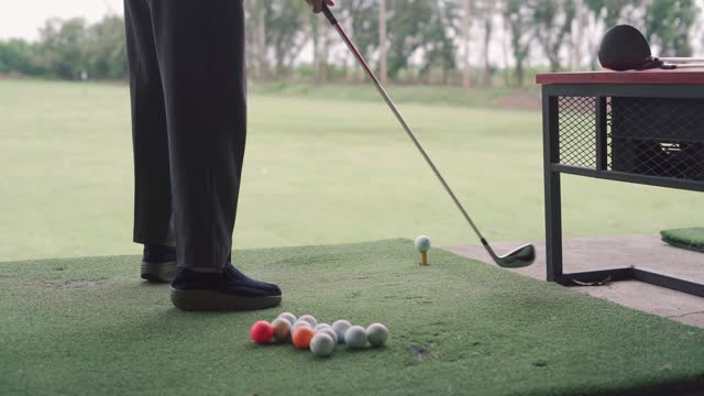 a senior woman driving the ball - driving range stock videos & royalty-free footage