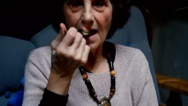 Senior woman eating cake