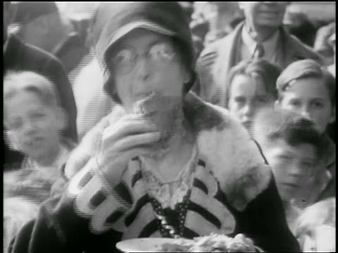 B/W 1929 senior woman eating slice of world's largest pie outdoors / Albion, NY / newsreel