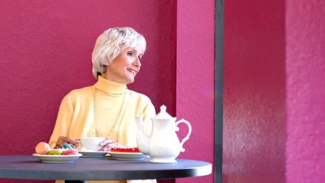 senior woman enjoying cup of coffee - one senior woman only stock videos & royalty-free footage