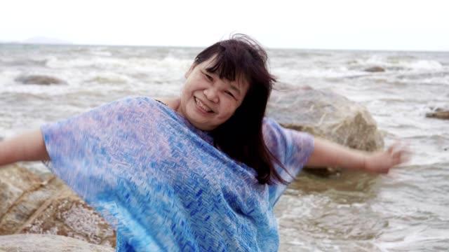 senior woman enjoying summer day at pattaya beach - human limb stock videos & royalty-free footage