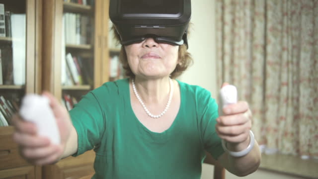 Senior woman enjoying VR indoors