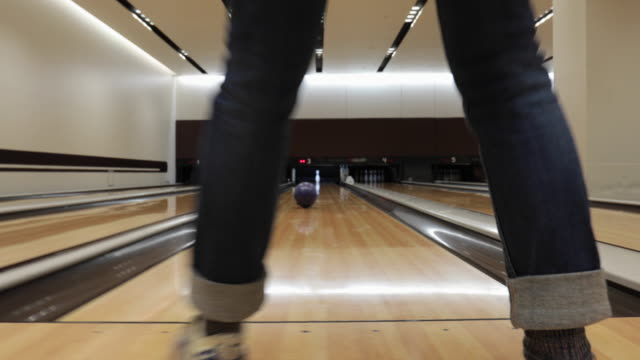 senior woman enjoys bowling - bowling alley stock videos & royalty-free footage