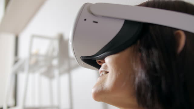 senior woman excited in virtual reality - cyberspace stock videos & royalty-free footage