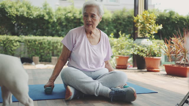senior woman exercising with dumbbell - health technology stock videos & royalty-free footage