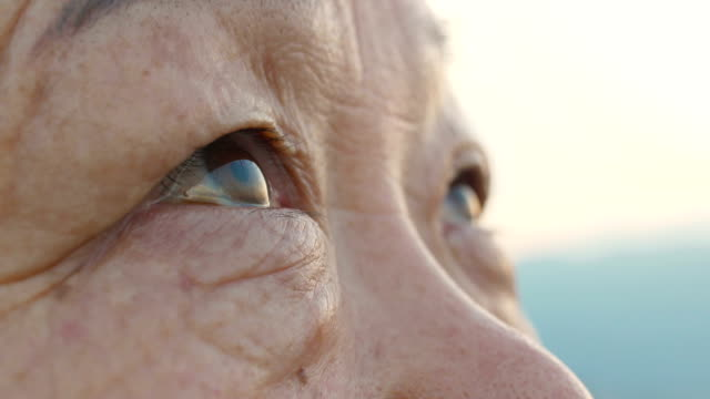 senior woman eye close-up - looking up stock videos & royalty-free footage