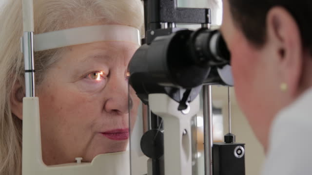 senior woman eye examination - ophthalmologist stock videos and b-roll footage