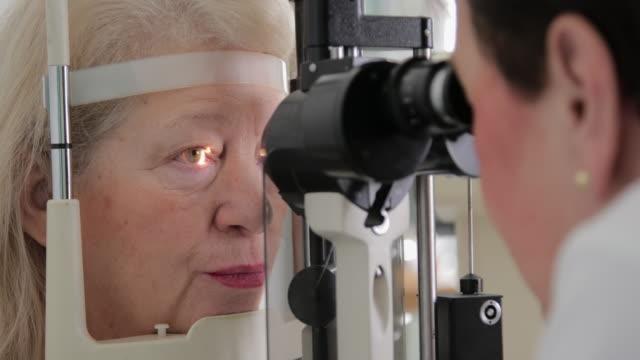 Senior woman eye examination