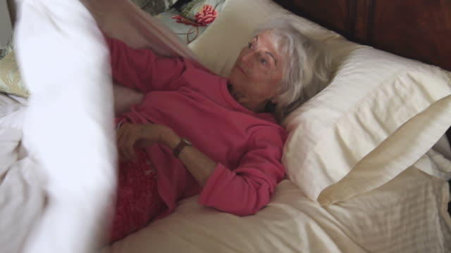 ms senior woman getting out of bed in morning / portland, oregon, usa - getting out stock videos & royalty-free footage