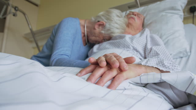 senior woman grieving while visiting her sick husband in hospital - cancer illness stock videos & royalty-free footage