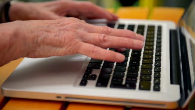 Senior woman hands typing