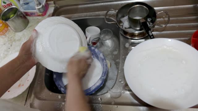 senior woman hands washing dishes - dishcloth stock videos & royalty-free footage
