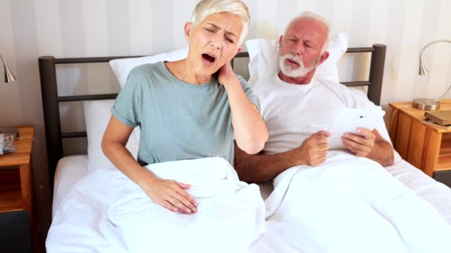 senior woman having a neck pain - body care stock videos & royalty-free footage