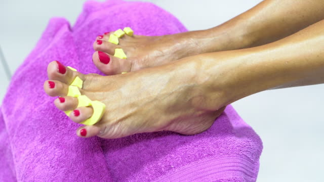 senior woman having a pedicure in a beauty spa - pedicure stock videos & royalty-free footage