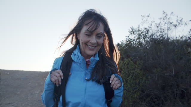 cu senior woman hiking in the mountains - active lifestyle stock videos & royalty-free footage