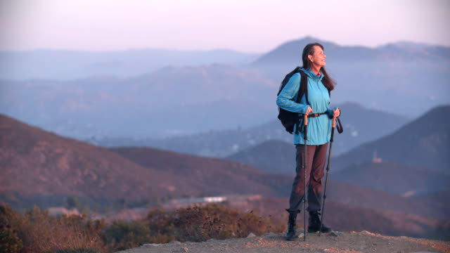 senior woman hiking in the mountains - climbing equipment stock videos & royalty-free footage