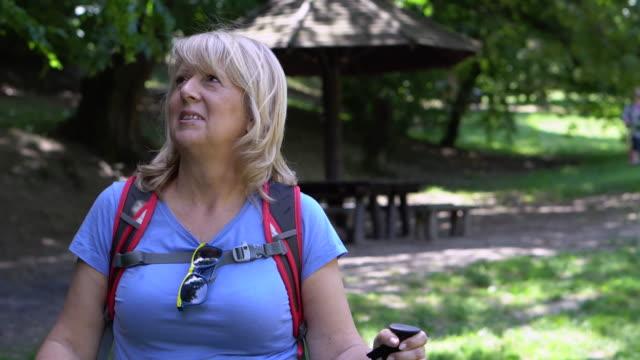 senior woman hiking - 60 64 years stock videos & royalty-free footage