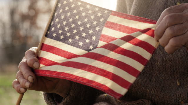 senior woman holding american flag - voting stock videos & royalty-free footage