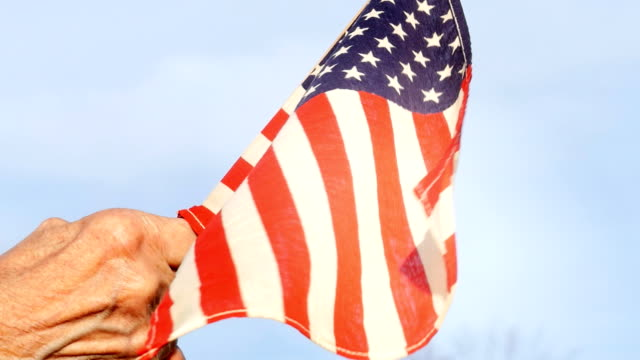 Senior Woman Holding American Flag