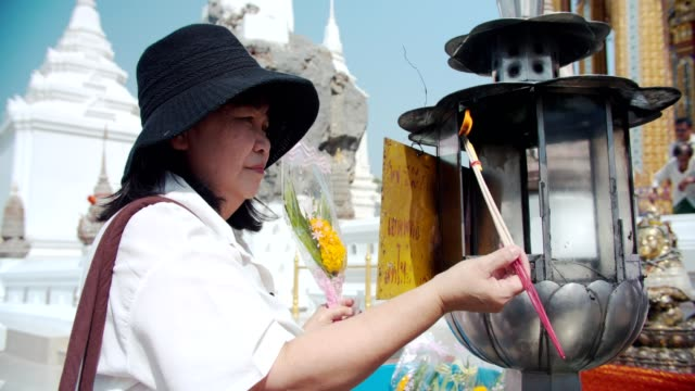 senior woman holding burning incense and praying - incense stock videos & royalty-free footage