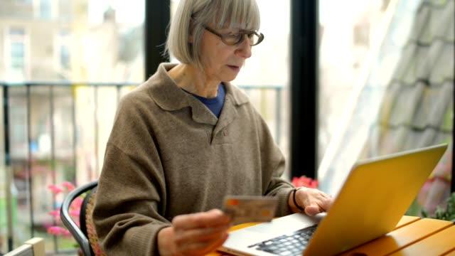 Senior woman home shopping