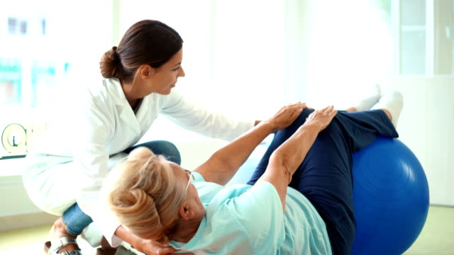 senior woman in physical rehab. - physical therapy stock videos & royalty-free footage