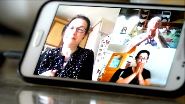 a senior woman in quarantine at home talking to her daughters - grandmother stock videos & royalty-free footage