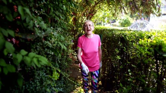 senior woman in the garden - formal garden stock videos & royalty-free footage