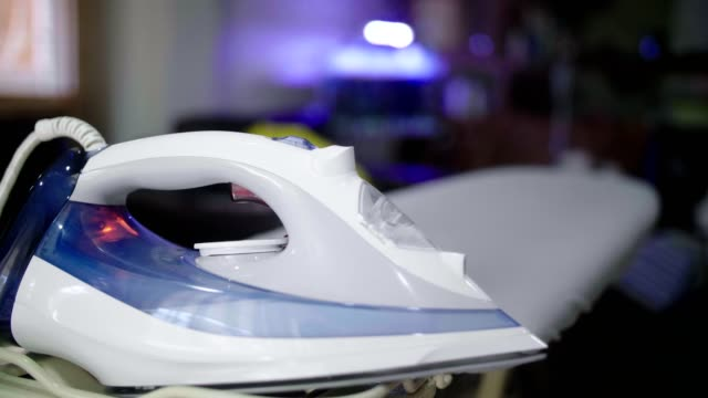 cu : senior woman ironing clothes on ironing board at home - ironing board stock videos & royalty-free footage