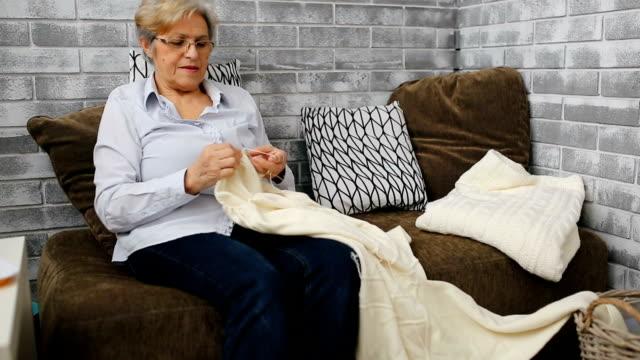 senior woman is knitting sweather - knitting stock videos & royalty-free footage