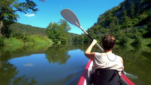 senior woman kayaking on idyllic river - kayaking stock videos & royalty-free footage
