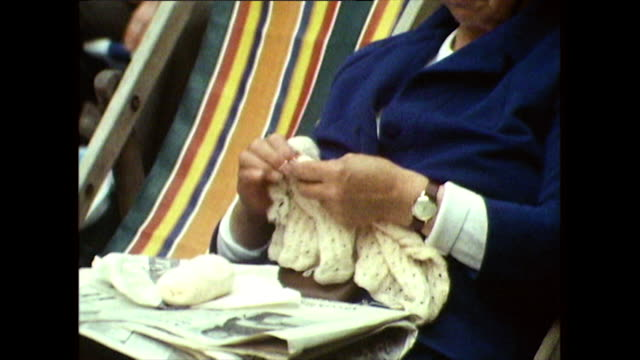 senior woman knits while sitting in deckchair; 1971 - outdoor chair stock videos & royalty-free footage