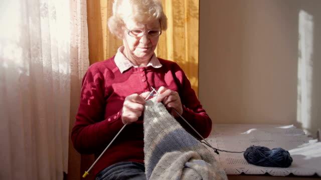 senior woman knitting - rocking chair stock videos & royalty-free footage