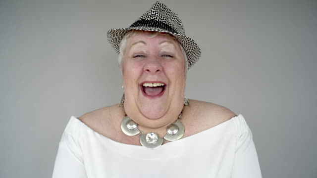 a senior woman laughing. - facial expression stock videos and b-roll footage