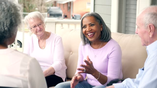 senior woman leads support group for senior adults - neighbor stock videos & royalty-free footage