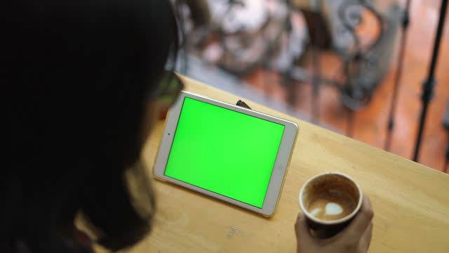 senior woman learning on digital tablet at coffee shop - electronic book stock videos & royalty-free footage