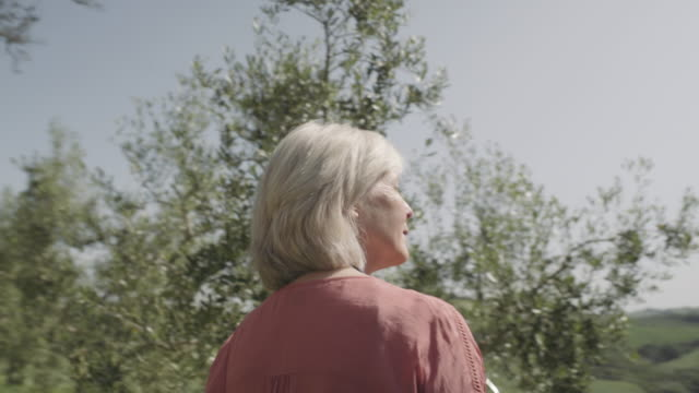 senior woman looking at landscape - dolly shot stock videos & royalty-free footage
